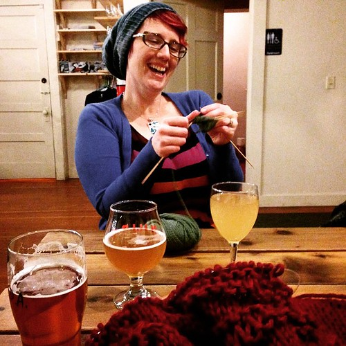 Knitting and drinking with @80skeins at Tuesday knit night! (IPA and bulky design prototype.)
