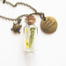 Brass pendant with dry flowers in tiny bottle