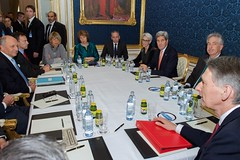U.S. Secretary of State John Kerry sits with French Foreign Minister Laurent Fabius, Baroness Catherine Ashton of the European Union, and British Foreign Secretary Philip Hammond, as well as German Ministry of Foreign Affairs Political Director Hans-Dieter Lucas (not pictured), sit at a table in Vienna, Austria, on November 21, 2014, amid a series of multilateral discussions about the future of Iran's nuclear program. [State Department photo/ Public Domain]