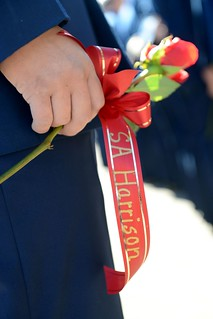 A Coast Guardsman holds a rose representing one of the 23 crew members who perished aboard the Coast Guard Cutter Blackthorn during the 35th annual Blackthorn Memorial ceremony in St. Petersburg, Fla., Wednesday, Jan. 28, 2015. The crew of the Blackthorn collided with the motor vessel Capricorn on Jan. 28, 1980, resulting in the service's worst peacetime disaster. (U.S. Coast Guard photo by Petty Officer 3rd Class Ashley J. Johnson)