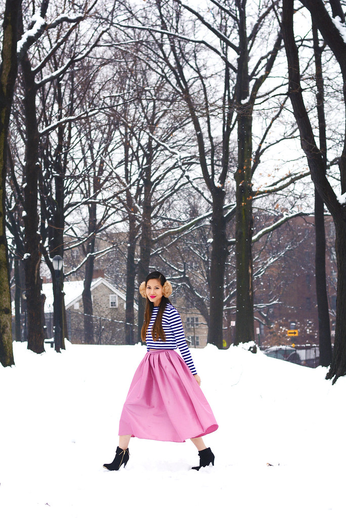 winter outfit pink skater midi skirt, blue stripe crop long sleeve top, fur earmuffs