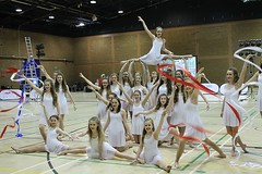 ballet(0.0), cheerleading(0.0), basketball(0.0), sport venue(1.0), event(1.0), sports(1.0), performing arts(1.0), gymnastics(1.0), entertainment(1.0), dance(1.0), performance(1.0), acrobatics(1.0), rhythmic gymnastics(1.0),