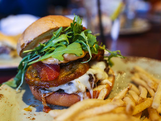 Fresh Ground Burger w/ Fried green tomatoes, house-cured bacon, arugula, and chipotle aioli - Table 9