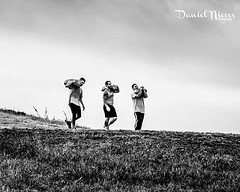 Had a photo shoot last weekend at sunrise at a park and saw these 3 guys working out. They were each carrying a sack full of what I assume is sand but am not really sure. They were carrying these sacks up a pretty long hill and back down again. I watched