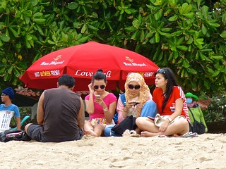 Digital girls on Kuta Beach .