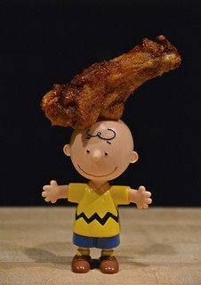 Charlie Brown Demonstrates the Art of Balancing Buffalo Chicken Wings on One's Head
