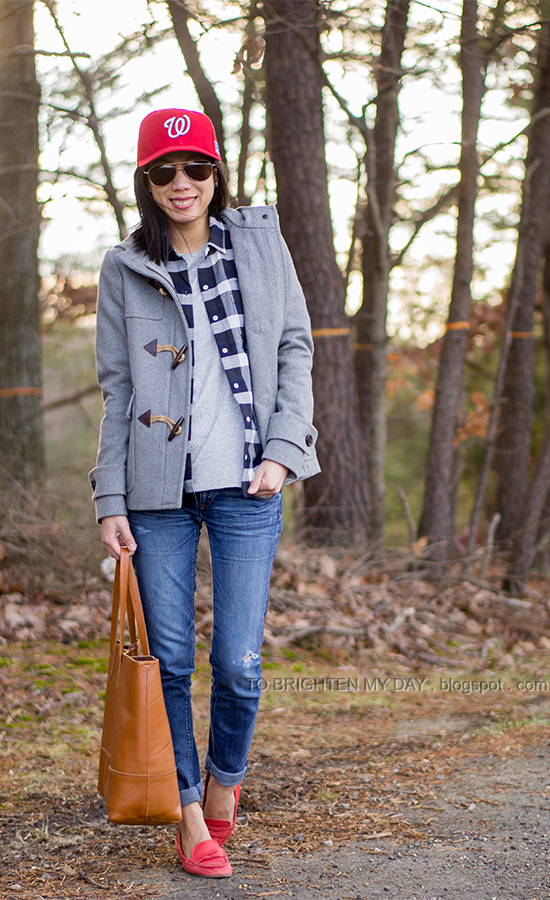 red cap, gray toggle coat, plaid shirt, cognac brown tote, red loafers