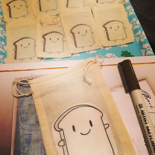 Still working away, drawing bread slices.