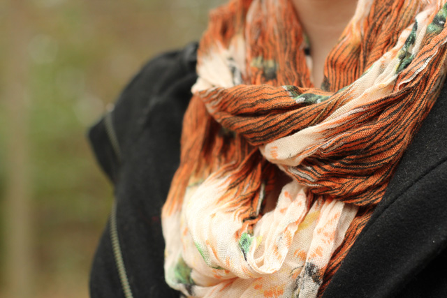 Rust Orange Fall Patterned Scarf with a Black Coat