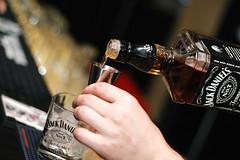 champagne(0.0), wine(0.0), guitar(0.0), drum(0.0), beer(0.0), alcohol(1.0), cool(1.0), photograph(1.0), distilled beverage(1.0), light(1.0), drink(1.0), black(1.0), alcoholic beverage(1.0),