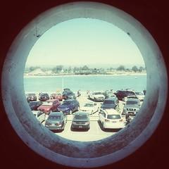 p]arking lot through porthole [Day 2776]