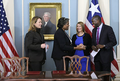 From left, Dana J. Hyde, CEO of Millennium Challenge Corporation; Assistant Secretary of State for African Affairs and former U.S. ambassador to Liberia Linda Thomas-Greenfield; Deputy Secretary of Management and Resources Heather Higginbottom; and Liberian Minister of Finance and Development Amara M. Konneh participate in a Compact Development Signing Ceremony at the U.S. Department of State in Washington, D.C., on February 25, 2015. [Millennium Challenge Corporation photo by Steve Ruark]