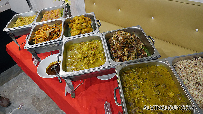 At the sumptuous buffet line, we got to sample Jerk Chicken ($13), Chicken Curry ($13), Curry Goat ($15), Catch of the Caribbean ($14), Caribbean Hand Cut Chips ($4.50), Rice and Peas ($3.50), Macaroni Pie ($4.50).