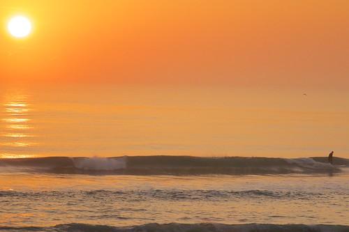 ocean sun sunrise dawn golden surf waves florida surfer peaceful surfboard indialantic