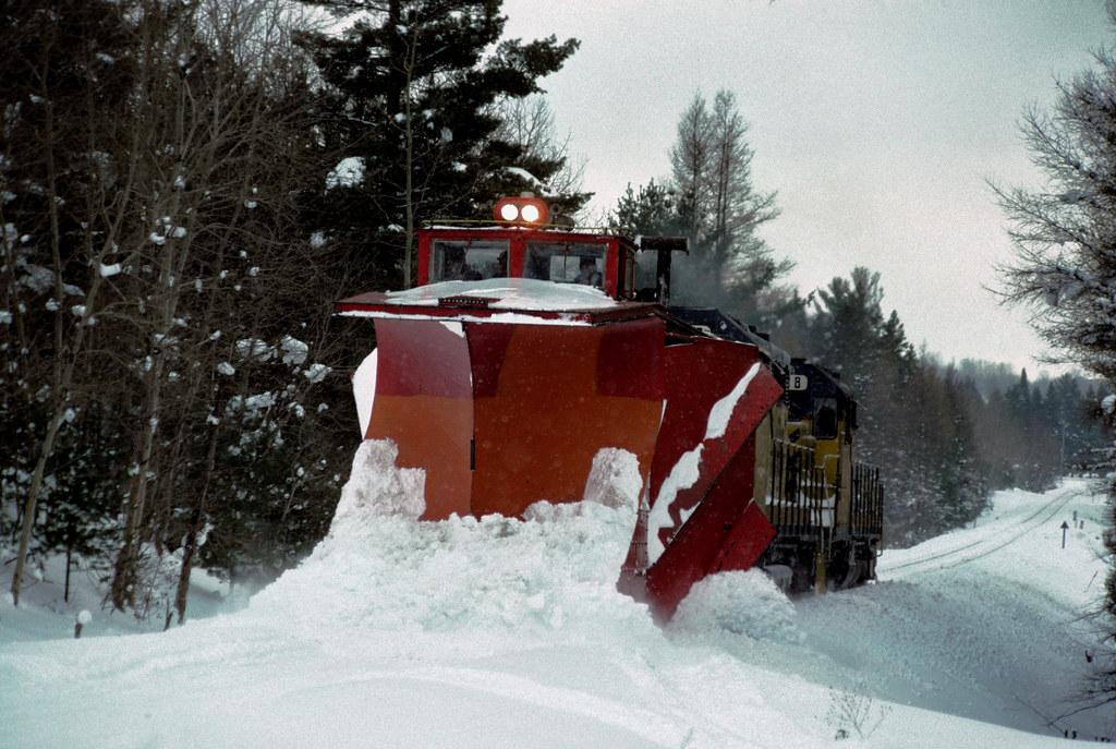 T&SBY plow train north of Boyne Falls  on 1-24-94
