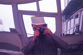 reflected self-portrait with Miranda 35ME camera and plastic képi