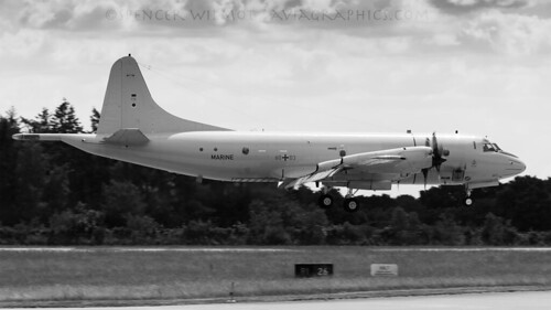 orion p3 lockheed militaryaviation monochrome blackandwhite clouds arrival approach airbase hohn germany landing aviation airplane aircraft airport airside plane turboprop antisubmarine madboom maritimepatrol tailstinger marine germannavy 6003 prop runway mpa p3c p3corion