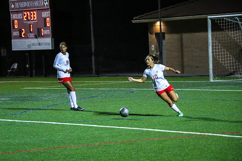 <p>Megan Garcia explosively pushing the ball up from her goal.</p>
