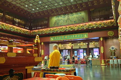 Yellow-robed monks chanting, Buddha Tooth Relic Temple