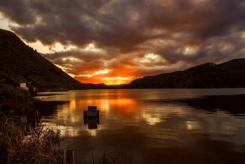 sunset newzealand lake water still rotorua