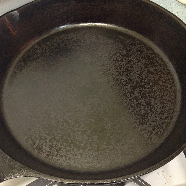 Halfway through seasoning a cast iron skillet on the stove top by Blake Winton