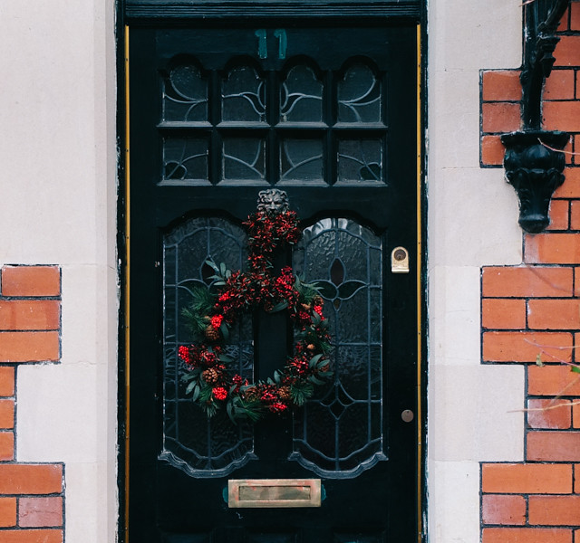 christmas wreath on black door