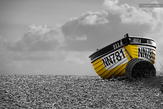 Yellow boat on a beach