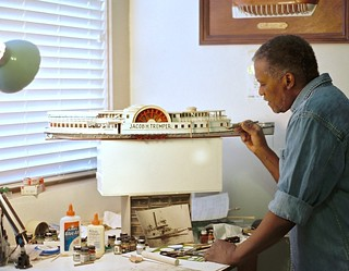 American artist and craftsman Rex Stewart working on waterline model of Jacob H. Tremper