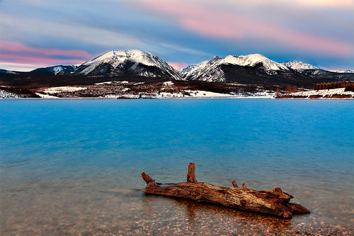 wood lake snow water clouds rockies evening log colorado rockymountains summitcounty lakedillon