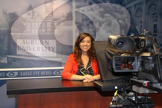 A student sits at the Eagle Eye anchor desk.