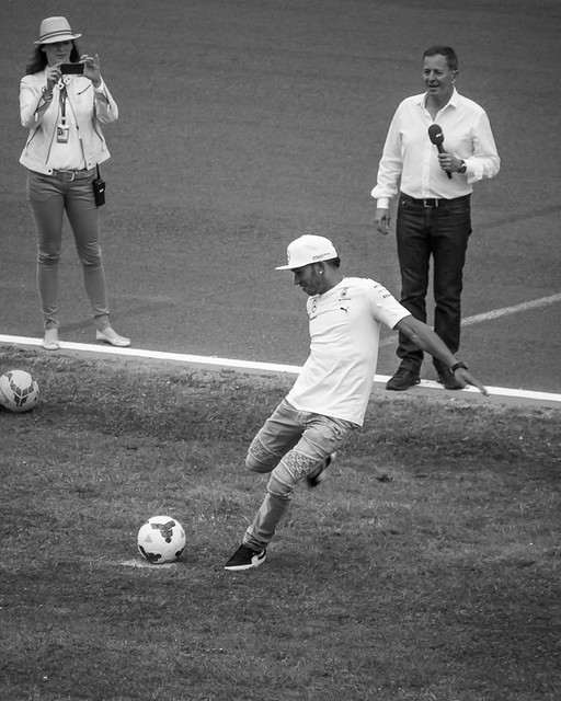 Lewis Hamilton plays football.