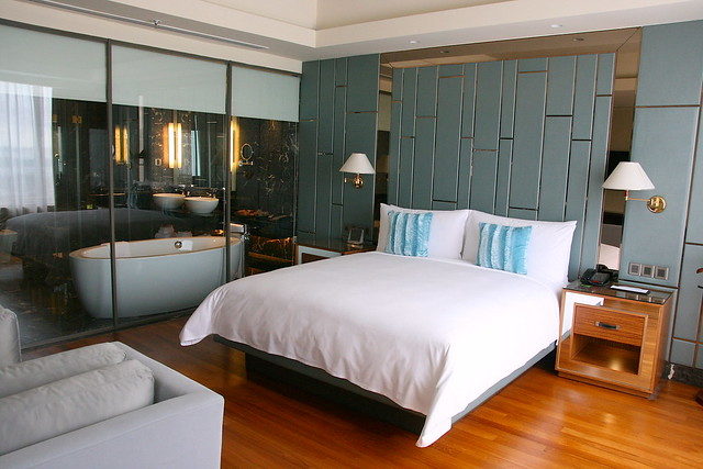 The bedroom in the Presidential Suite with see-through bathroom