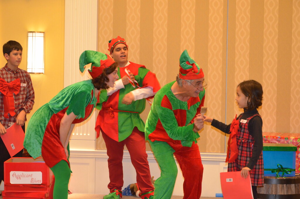 <p>Applicant Elves getting recognition from Santa's Elves and are accepted into the Santa's workshop<br /> <br /> Photo by the Courtesy of the Embassy of Poland</p>