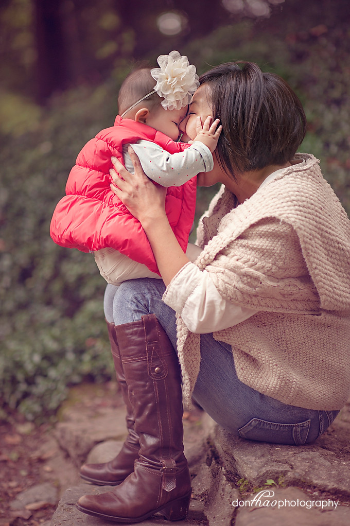 mother daughter kisses in photographs