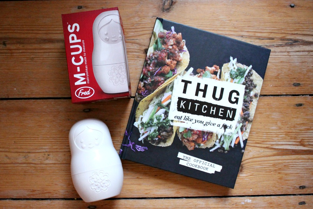 thug kitchen book and matryoshka measuring cups