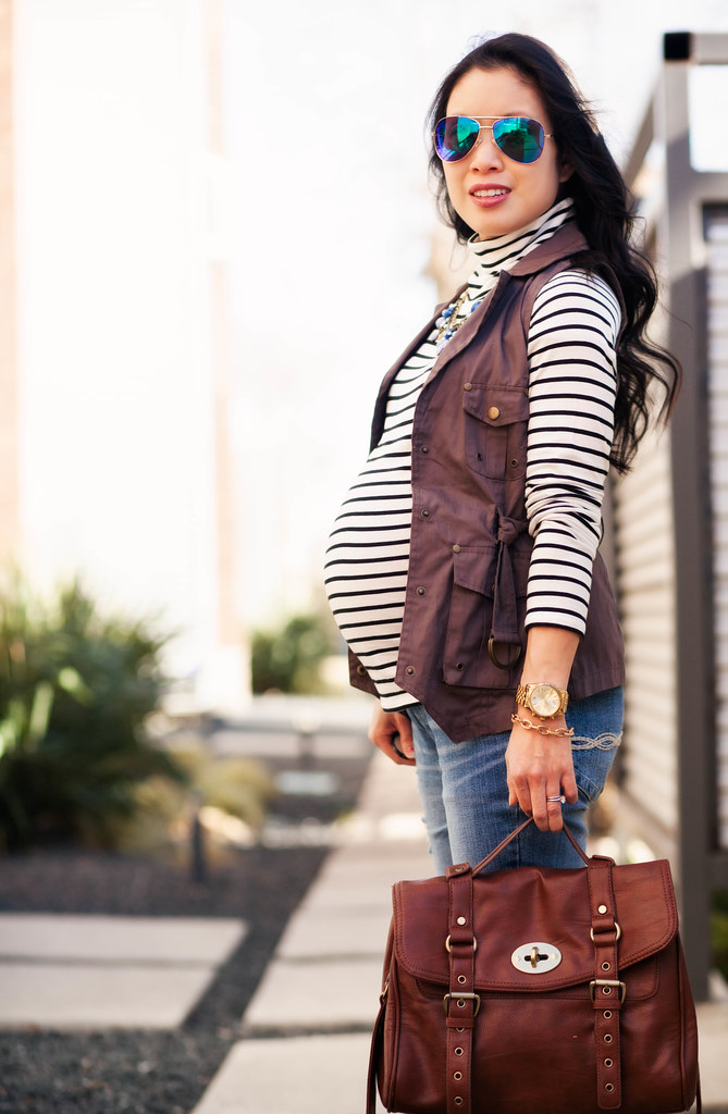https://cuteandlittle.com | petite fashion blog | maternity | blue mirrored aviators, striped turtleneck, military utility vest, motherhood maternity distressed boyfriend jeans, leopard pumps | outfit