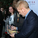 LMU School of Film & Television posted a photo:	Branagh autographs a Hamlet poster for an LMU student. | Photo by Juan Tallo