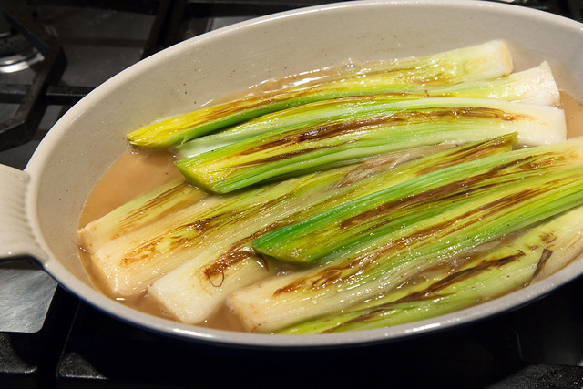 leeks in pan with broth