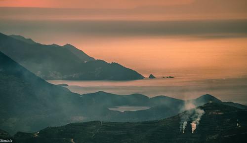 sunset sea mountains fog fire nikon smoke greece crete nikkor heraklio cretansea siminis