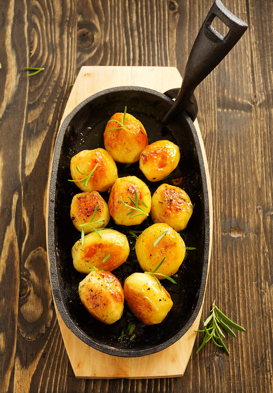 Baked potatoes with rosemary.