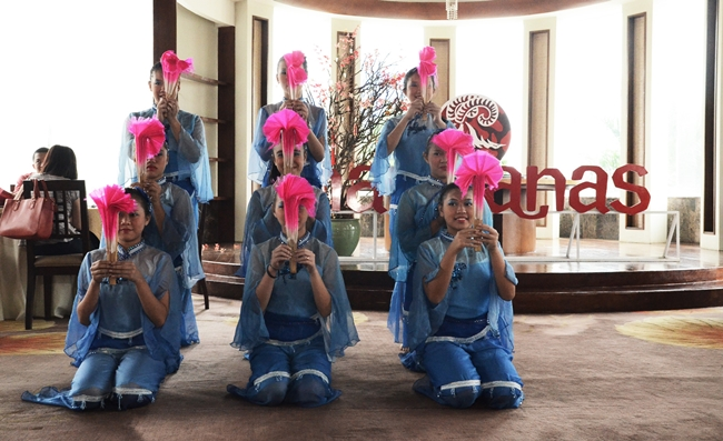 The Philippine Academy of Sakya Dance Troupe performing a traditional Chinese Dance using fans that resemble flower petals