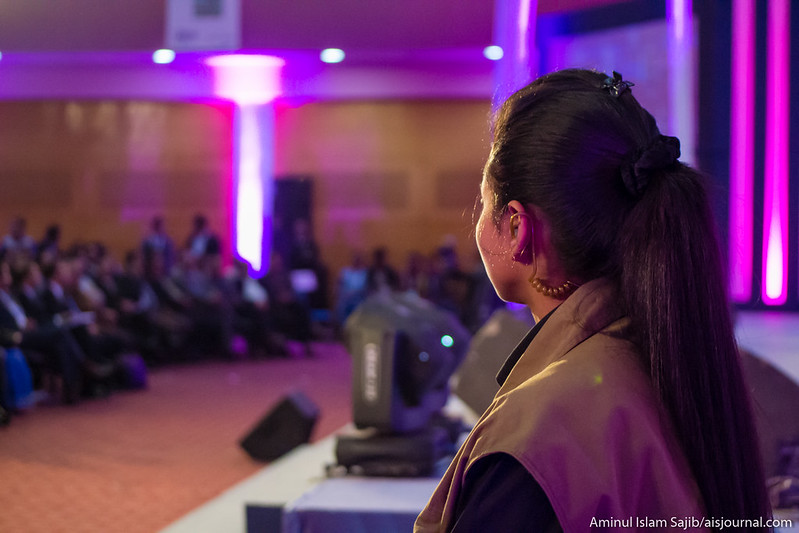 A security personnel looks at the audience during the closing ceremony of Digital World 2015