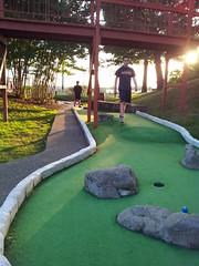 backyard(0.0), sport venue(0.0), estate(0.0), lawn(0.0), grass(1.0), sports(1.0), recreation(1.0), outdoor recreation(1.0), golf(1.0), miniature golf(1.0), golf course(1.0),