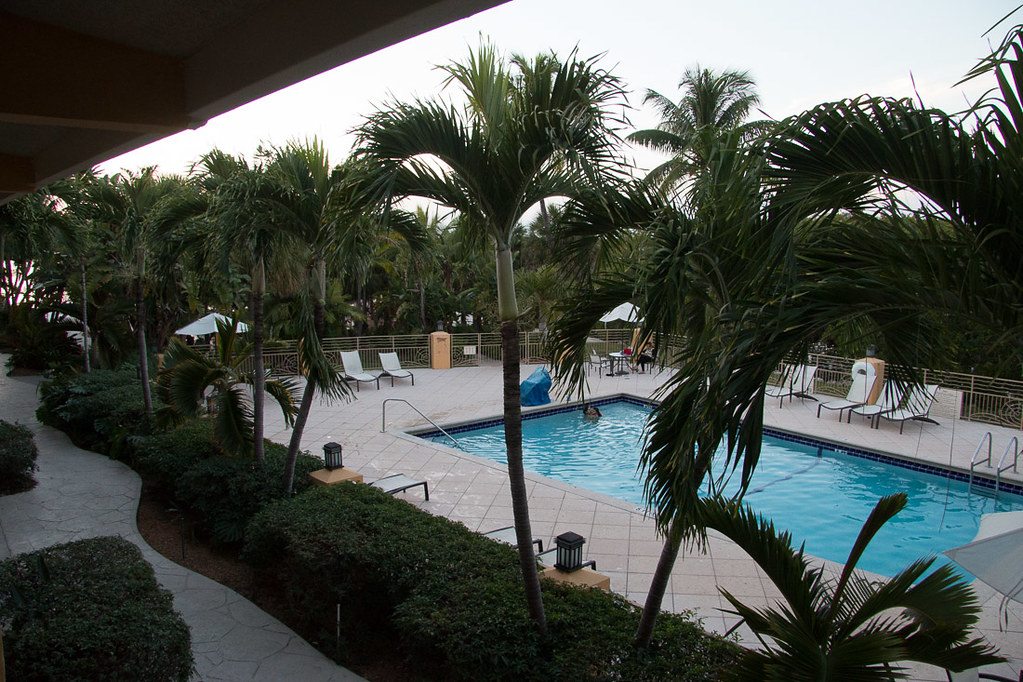 View of pool from hotel room balcony