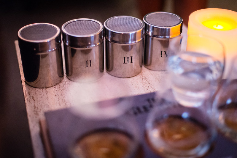 Near the glasses were four labeled canisters containing