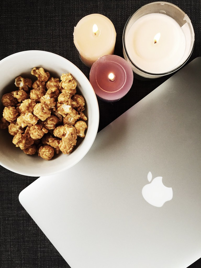 Snacking on popcorn coated smooth caramel and crunchy peanut butter #handmadeInEngland #popcorn | December 2014