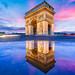 Arc de Triomphe puddle mirror at dusk by Loïc Lagarde
