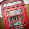 So harsh have been the budgetary cuts to public services in Cameron's Britain that this village library has been reduced down to just a phone box.