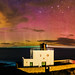 Bamburgh aurora panorama by Mike Ridley.