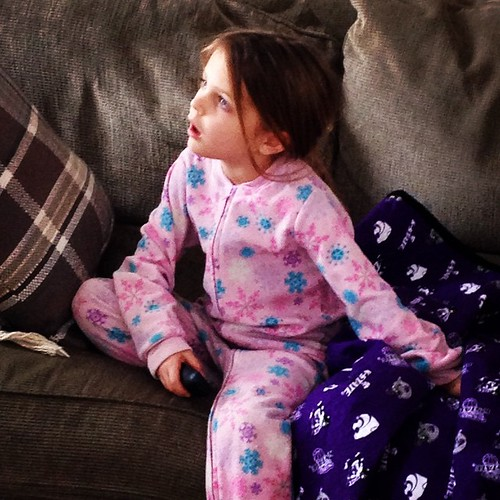 Snow day parenting at its finest:  Footies and TV.